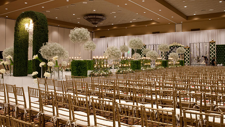 Kalahari ballroom set for an indoor wedding with beautiful floral display and archway