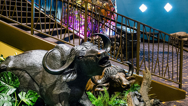 Two Ram sculptures next to a staircase at Kalahari Resorts & Conventions in Pocono Mountains, Pennsylvania