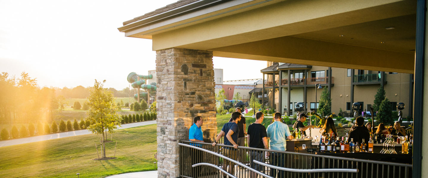 Group of guests enjoying drinks on the outdoor patio bar at Kalahari Resorts & Conventions in Pocono Mountains, Pennsylvania